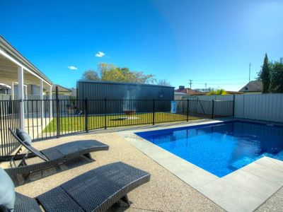 Photo for Solar heated in ground pool, pet friendly, swing set and great rear yard.
