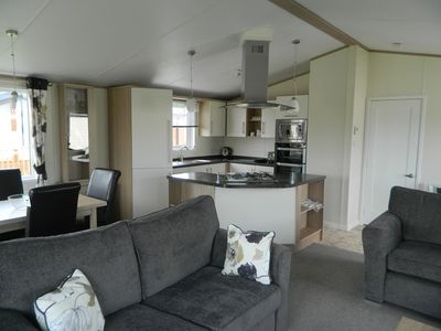 Picture showing lounge, kitchen and dining area