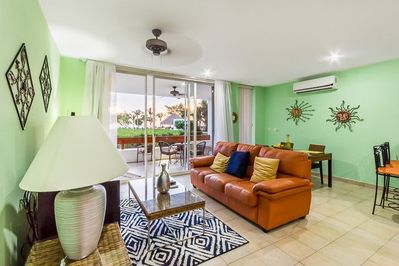 The living room is enhanced by the lush garden view just beyond the sliding glass doors
