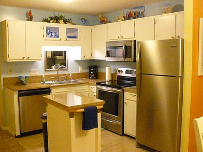 Updated kitchen with granite counter tops and new stainless steel appliances