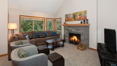 Cozy living area with presto log fireplace and flat screen TV.
