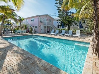 Photo for FLAMINGO #1 BEACH CONDO 3BED, KING BED, ONLY 50 STEPS TO BEACH,POOL