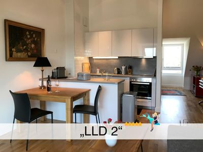 Photo for Luxurious island apartment with picture window, lake view and sunset