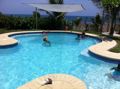Enjoy the breeze and the view of the ocean from the pool...