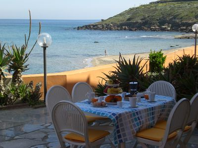 Photo for Apartment directly on the beach with direct sea view solarium terrace