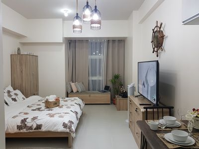 Photo for Your home away from home,near to Shangri-La Plaza @ Twin Oaks Place