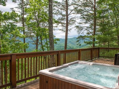 Photo for Charming family cabin with private hot tub, shared pool, & secluded location