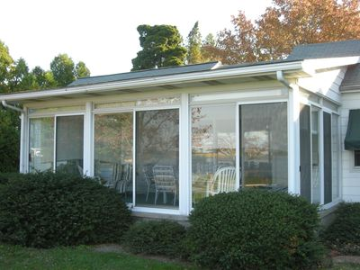 The 3 season sunroom is a great place to eat dinner and enjoy the view.