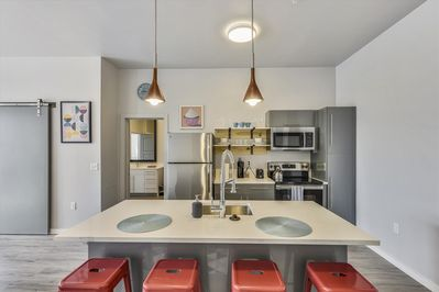 Kitchen Features Stainless Appliances and Modern Industrial Design Touches