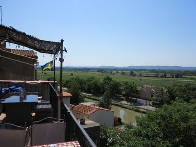 Photo for At the Canal du Midi with wonderful views of the vineyards and mountains with garden and pool