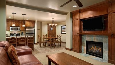 Main living room with gas fireplace and flat screen.  Full kitchen and dining.