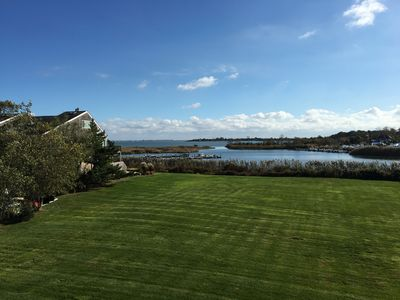 Photo for Tranquil immaculate bayfront duplex close to the Hamptons and the North Fork