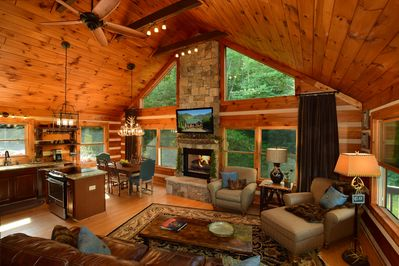 Light and bright den (with Smart TV) open  to fireplace, dining area,and kitchen
