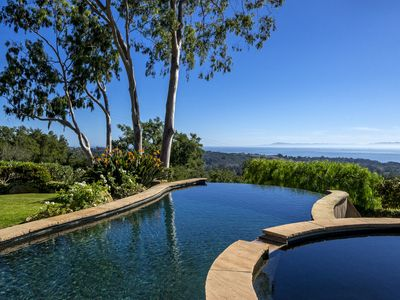 The terrace at Tuscan Charm boasts a heated infinity pool with ocean views