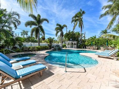 Photo for Tropical Breeze Resort - 2 Bedroom Suite w/ Full Kitchen - Sleeps 8 - Steps to Siesta Key Beach and Village - INCLUDED: Daily Housekeeping, Bikes, 2 Pools/1 Spa, Beach Chairs, Beach Towels, WiFi, Parking , Games, BBQs and More!