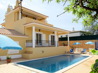 Photo for This 4-bedroom villa for up to 8 guests is located in Carvoeiro and has a private swimming pool, air