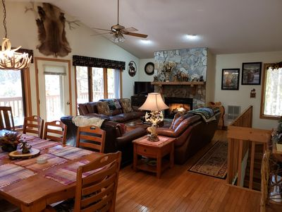 Living Room with gas fire place, porch with mountain view and BBQ grill