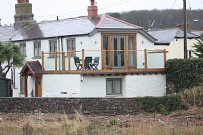 Photo for Refurbished Cottage With Large Balcony Overlooking River Neet