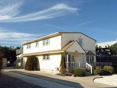 Photo for Located just 2 blocks to the beach. Enjoy cool nights in the screened in porch out back
