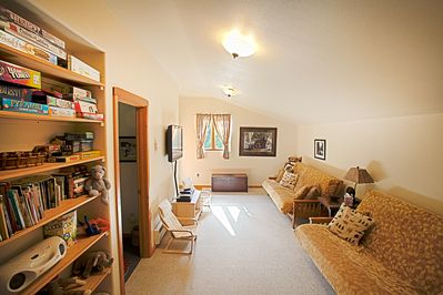 Family room with 2 full size futons, XBox, tv w/satellite, and foosball table