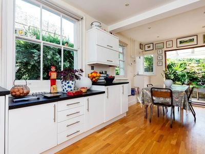 Photo for Stunning home with garden located on a quiet street near Ravenscourt Park(veeve)