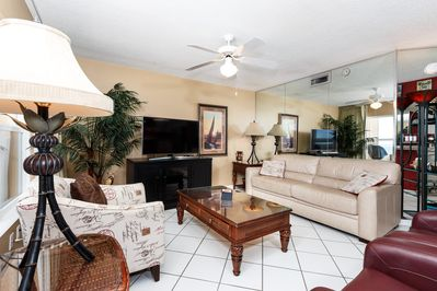 Living Area  - The entertainment center features a flat screen tv, dvd player, and stereo.