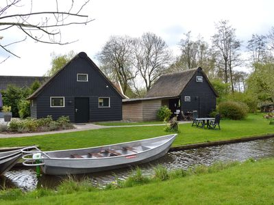 Photo for Modern holiday home in old centre of Giethoorn with 2 hours of boat use