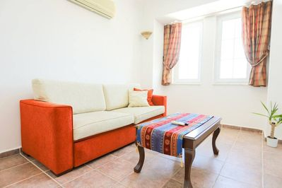 Our home PINE GROVE has a bright and spacious living room.