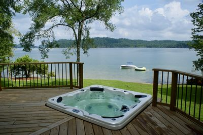 Relax in the hot tub while enjoying the great lake view.