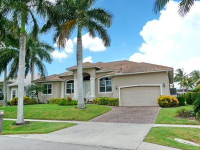 Photo for Perfectly located waterfront house w/ heated pool & short walk to beach