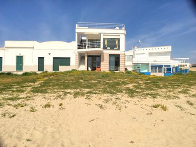 Photo for Apartment located in Torre Pali, directly on the sandy beach, on the ground floor, with a unique vie