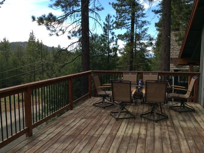 Large front deck with comfortable patio set.