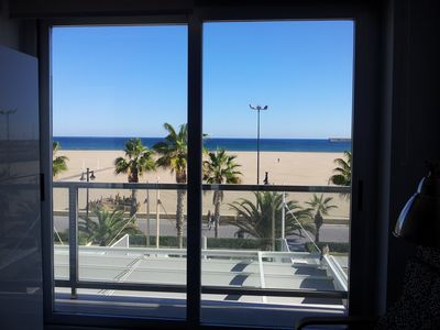 Photo for Malvarrosa II, apartment on the 1st line of the beach with amazing sea views