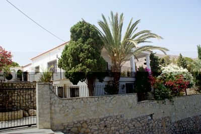 The villa with iron gate and parking