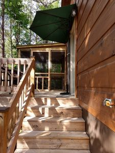 Photo for Wooded Tiny Retreat With Screened Porch-Near Lake Lure and Chimney Rock Park (Cabin E)