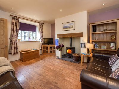 Photo for This delightful and well-presented semi-detached cottage is stylish inside and out and a perfect bas
