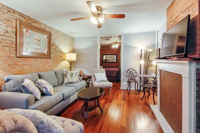 Soothing living room,  queen sleeper sofa and the bed room through the door.