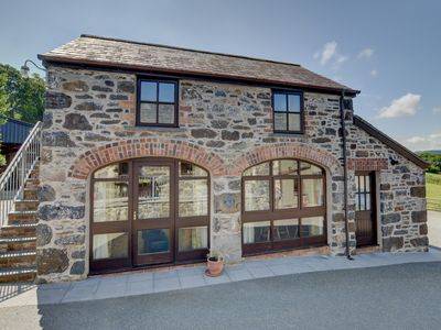 Photo for On the owners' farm in Snowdonia National Park a mile from Llanrwst is Carnedd Daffydd a detached co