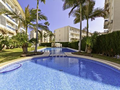 Photo for Modern apartment in beachfront complex with private parking in garage