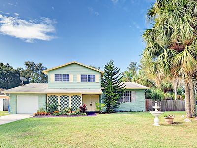 Photo for Tropical 4BR w/ Screened Porch & Private Pool, Minutes to the Beach & Airport