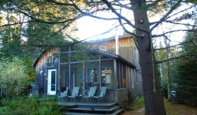Photo for Charming cottage on private beach on the edge of the red river