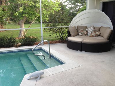 Pool deck with cabana bed for relaxing. Large private side yard.