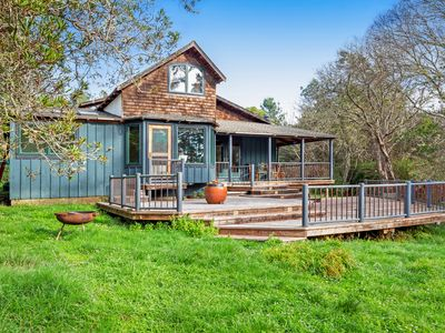 Photo for Charming, custom home w/ a large deck in a peaceful, park-like setting
