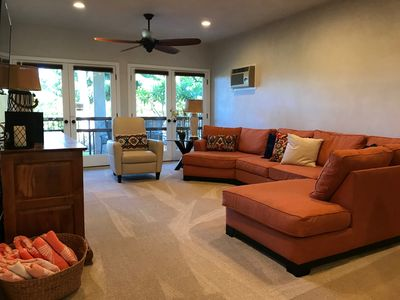 Large living area with french door access to lanai & garden view.
