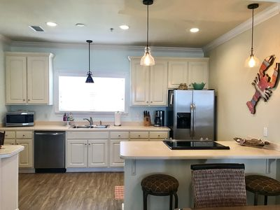 Open kitchen with new stainless appliances