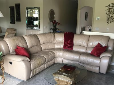 LIVING ROOM:  leather sectional with reclining seats on each end.