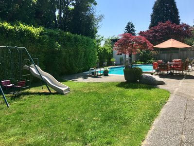 Beautiful backyard with children's swingset, and the pool!