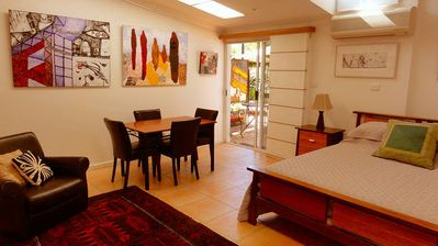 Spacious studio style apartment opens out to the pool area.