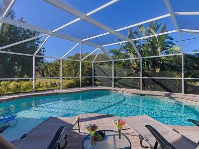 Photo for in walking distance to Cape Coral Library  huge Swimming Pool with built in sunbathing shelf