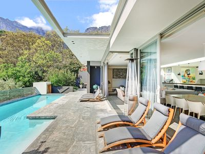 Photo for Modern upmarket villa with 4 bedrooms, en-suite, spectacular views in Camps Bay